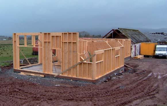<p>Timber framing to ground floor, showing OSB racking board on the inside.</p> <p>© Steve Mackan</p>