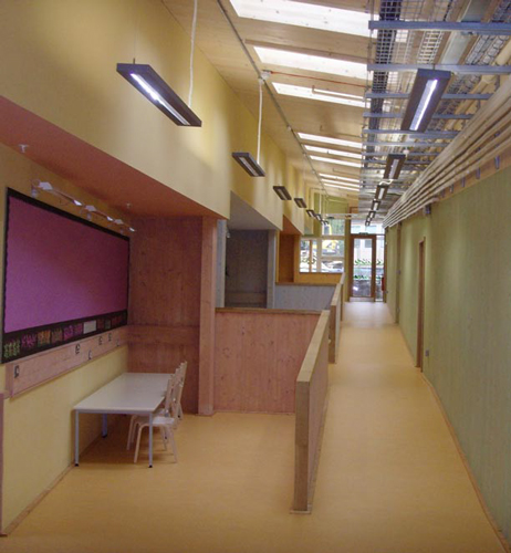<p>School corridor showing natural day lighting and accessible service runs.</p> <p>© Gaia Architects</p>