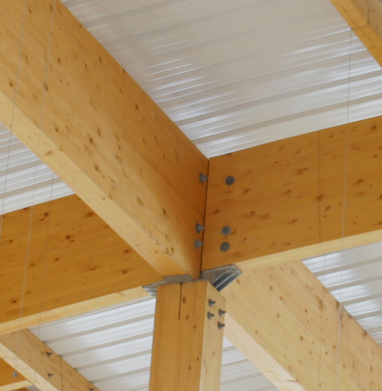<p>Head of timber column to glulam roof member.</p> <p><span>© </span><span>B&K Structures</span></p>