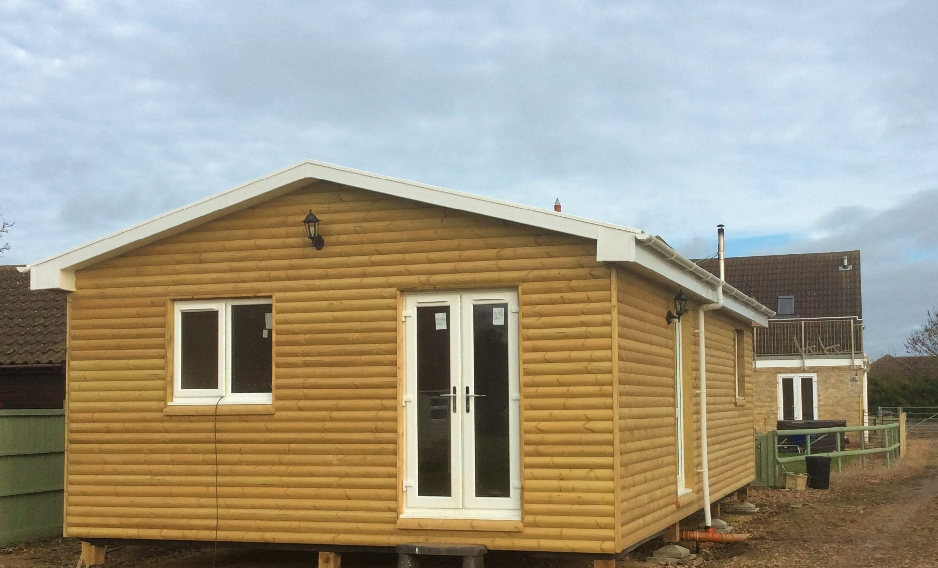 One of our Lodges with the fabulous rounded Log cladding in Cambridgeshire