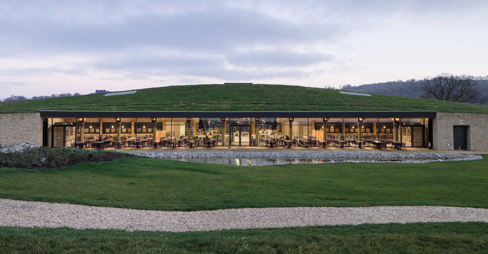<p>With its gently mounded green roof, the new visitor building merges into the local Cotswold landscape. © Paul Miller</p>