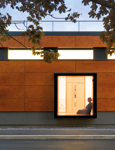 <p><span>External walls are clad with a rainscreen of laminated timber panels. © Fotohaus</span></p>