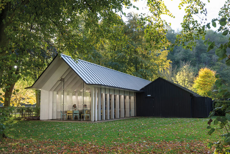<p><span>The new visitor centre is set in a grove of large mature trees.</span></p> <p><span>© Giles Rocholl</span></p>